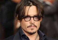 Johnny Depp cere daune de peste 25 de milioane dolari