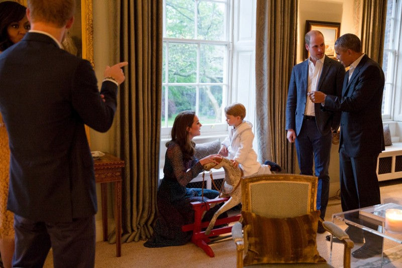 Handout photo issued by Kensington Palace of US President Barack Obama (right) talking with Britain's Prince William (2nd right) while Catherine, Duchess of Cambridge plays with Prince George as he rides a rocking horse while the First Lady Michelle Obama talks to Prince Harry (left) Friday April 22, 2016.   Kensington Palace/Pete Souza/White House Photographer/PA Wire/Handout via ReutersATTENTION EDITORS - THIS IMAGE WAS PROVIDED BY A THIRD PARTY. EDITORIAL USE ONLY. NO RESALES. NO ARCHIVES.      TPX IMAGES OF THE DAY